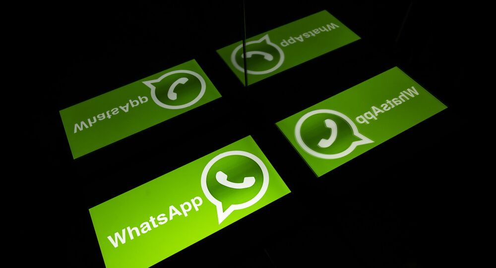 (FILES) This file photo taken on October 5, 2020 shows the logo of mobile messaging service WhatsApp on a tablet screen in Toulouse, southwestern France
