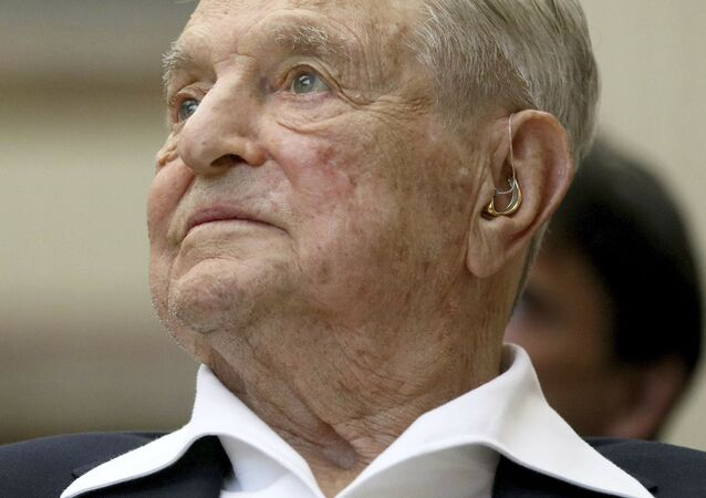 FILE - In this June 21, 2019, file photo, George Soros, Founder and Chairman of the Open Society Foundations, looks before the Joseph A. Schumpeter award ceremony in Vienna, Austria. Soros, the billionaire investor and philanthropist who has long been a target of conspiracy theories, is now being falsely accused of orchestrating and funding the protests over police killings of black people that have roiled the United States