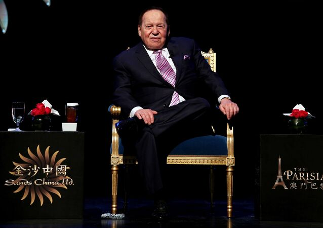 FILE PHOTO: Las Vegas Sands Corp Chairman and Chief Executive Sheldon Adelson attends a news conference on the opening of Parisian Macao in Macau, China September 13, 2016