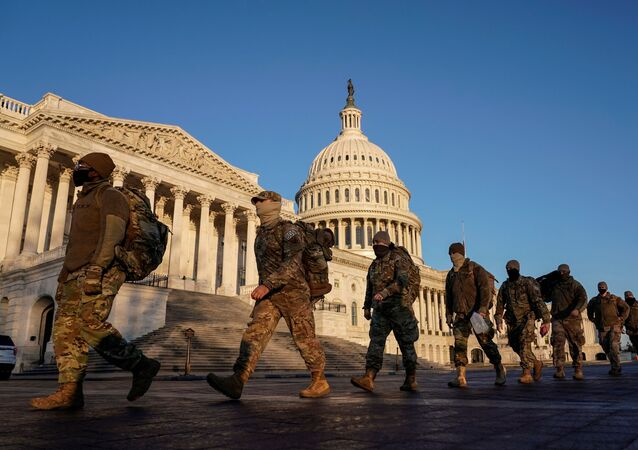 Members of the National Guard arrive at the U.S. Capitol as Democratic members of the House prepare an article of impeachment against U.S. President Donald Trump in Washington, U.S., January 12, 2021