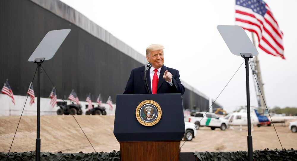 U.S. President Donald Trump gestures as he speaks during a visit at the U.S.-Mexico border wall, in Alamo, Texas, U.S., January 12, 2021