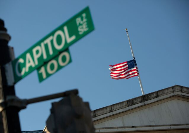 A flag flies at half-mast at the Longworth House Office Building across from the U.S. Capitol building to honor slain Capitol Police Officer Brian Sicknick on Capitol Hill in Washington, U.S., January 10, 2021