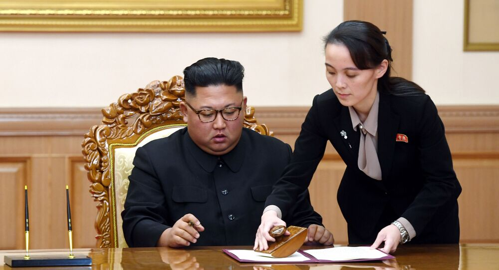 In this Sept. 19, 2018, file photo, Kim Yo Jong, right, sister of North Korean leader Kim Jong Un, helps Kim sign joint statement following the summit with South Korean President Moon Jae-in at the Paekhwawon State Guesthouse in Pyongyang, North Korea. Kim's prolonged public absence has led to rumors of ill health and worries about how it could influence the future of what one analyst calls Northeast Asia's Achilles' heel, a reference to the North's belligerence and unpredictable nature.