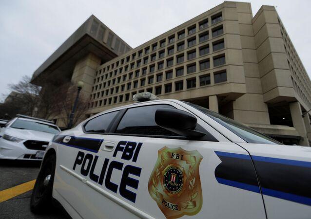 FILE PHOTO: FBI Police vehicles sit outside FBI building in Washington