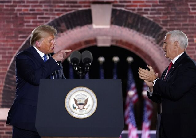 President Donald Trump joins Vice President Mike Pence on stage after Pence spoke on the third day of the Republican National Convention at Fort McHenry National Monument and Historic Shrine in Baltimore, Wednesday, Aug. 26, 2020