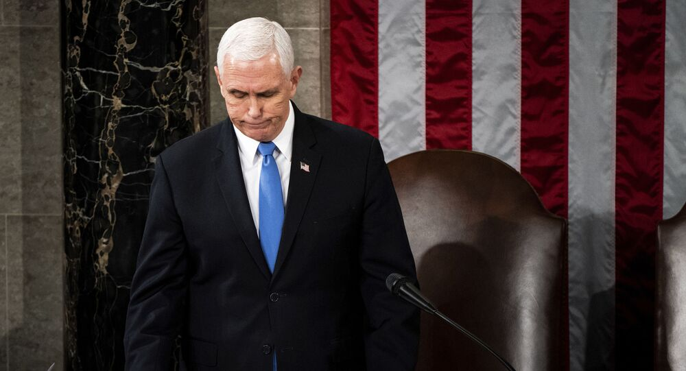 Vice President Mike Pence officiates as a joint session of the House and Senate convenes to confirm the Electoral College votes cast in November's election, at the Capitol in Washington, Wednesday, Jan. 6, 2021.