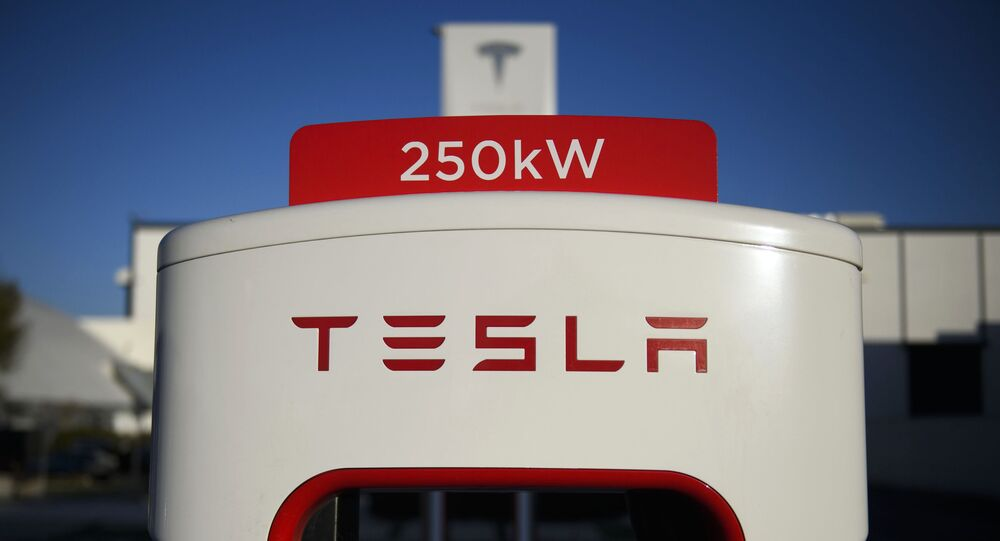 (FILES) In this file photo a Tesla logo is seen on a 250kW electric vehicle charging station at the Tesla Inc. supercharger station on January 4, 2021 in Hawthorne, California.