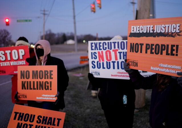 Activists in opposition to the death penalty gather to protest the execution of Lisa Montgomery, who is scheduled to be the first woman put to death by the federal government in nearly 70 years, at the United States Penitentiary in Terre Haute, Indiana, U.S. January 12, 2021