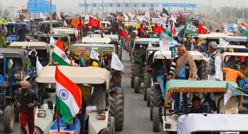 Farmers participate in a tractor rally to protest against the newly passed farm bills, on a highway on the outskirts of New Delhi, India, January 7, 2021
