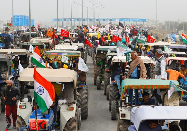 Farmers participate in a tractor rally to protest against the newly-passed farm bills, on a highway on the outskirts of New Delhi, India, 7 January 2021