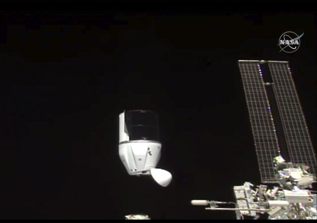 This photo provided by NASA shows SpaceX's Dragon undocking from International Space Station on Tuesday, Jan. 12, 2021.  SpaceX's Dragon cargo capsule undocked with 12 bottles of Bordeaux wine and hundreds of snippets of Merlot and Cabernet Sauvignon vines