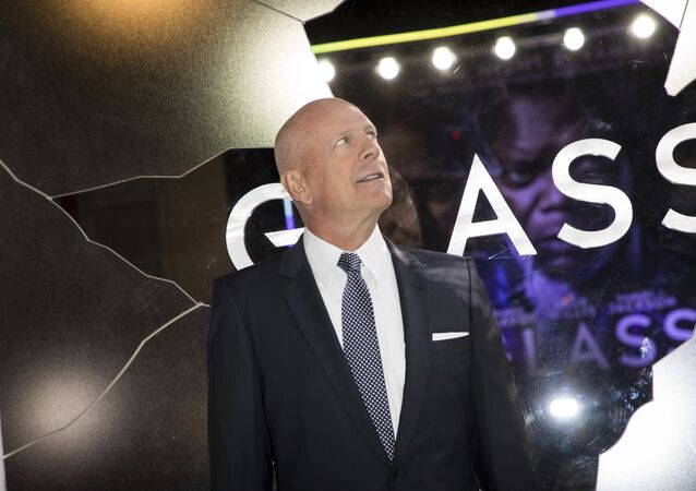 Actor Bruce Willis poses for photographers upon arrival at the premiere of the film 'Glass', in London, Wednesday, Jan. 9, 2019