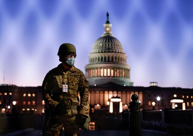 Members of the National Guard gather at the U.S. Capitol as the House of Representatives prepares to begin the voting process on a resolution demanding U.S. Vice President Pence and the cabinet remove President Trump from office, in Washington, U.S., January 12, 2021