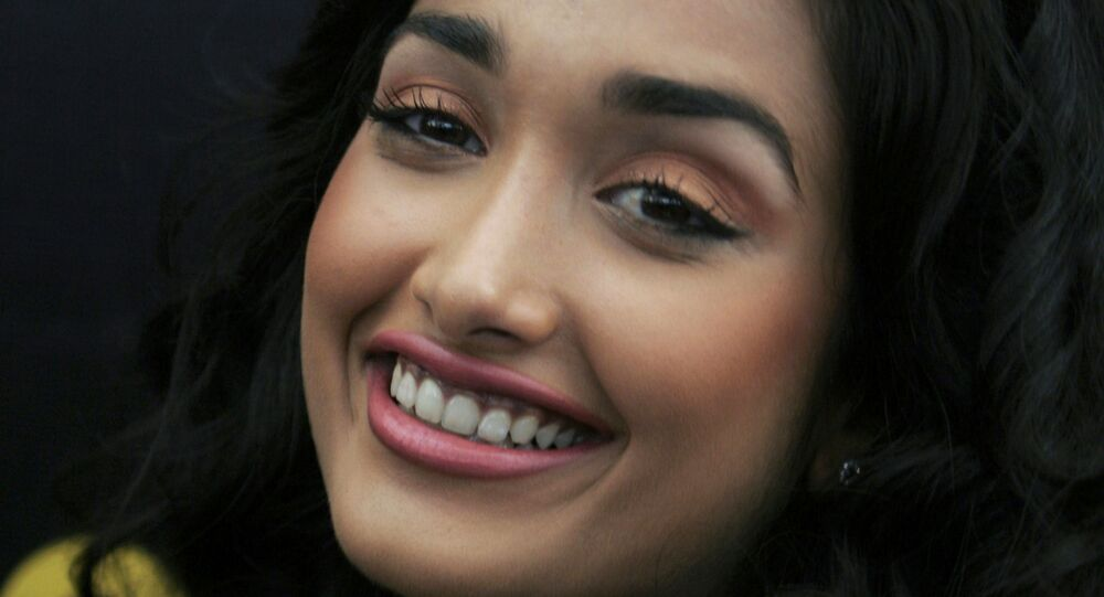 FILE - In this Dec. 19, 2008 file photo, Bollywood actress Jia Khan smiles during a promotional event of her forthcoming Hindi movie Ghajini in Bangalore, India. Police said the son of a Bollywood couple was arrested Monday, June 10, 2013 on suspicion of abetting the suicide of Khan.
