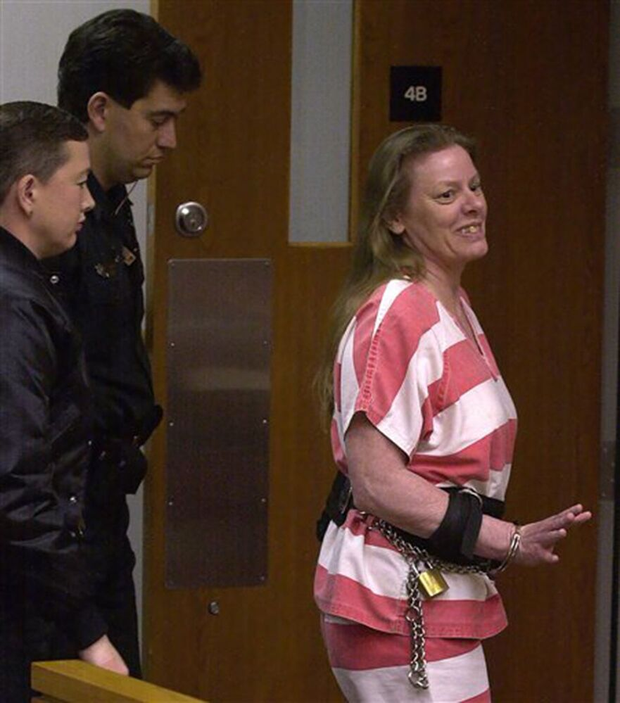 Serial Killer Aileen Wuornos waves at members of the court and thanks Judge Victor Musleh as she leaves courtroom 4A in the Marion County Judicial Center in Ocala, Florida Thursday afternoon 22 February 2001. Wuornos is presently on death row for the murder of six men between 1989 and 1990 in Central Florida.
