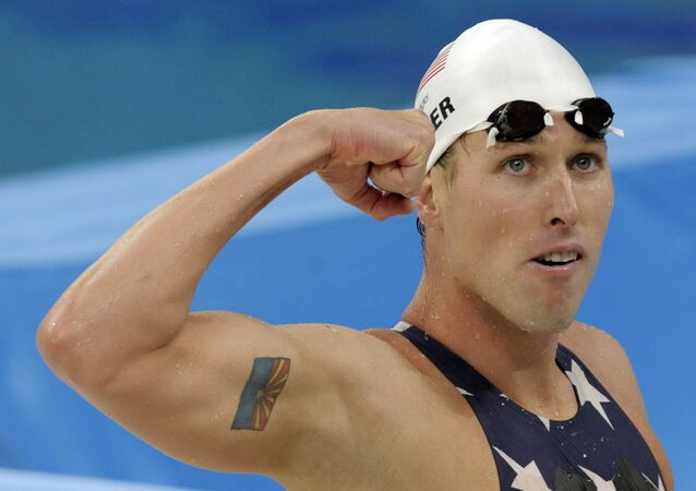 U.S. relay swimmer Klete Keller reacts after a men's 4x200-meter freestyle relay heat during the swimming competitions in the National Aquatics Center at the Beijing 2008 Olympics in Beijing, Tuesday, Aug. 12, 2008