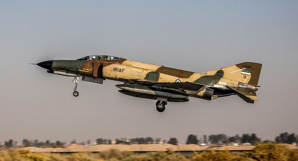 A handout picture made available by the Iranian Army office on November 2, 2020 shows an Islamic Republic of Iran Air Force F-4E Phantom II fighter-bomber aircraft flying during an aerial exercise in Isfahan in central Iran