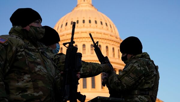 Members of the National Guard gather at the U.S. Capitol in Washington - Sputnik International
