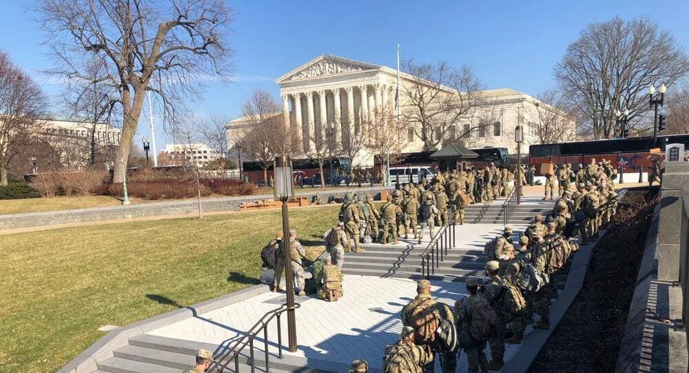 Additional National Guard forces arrive to the US Capitol from the area of the Supreme Court