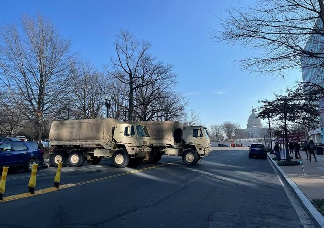 Military trucks block streets adjacent to the Capitol area in Washington, DC
