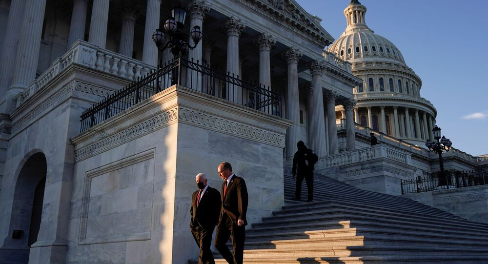 Members of the US Congress depart after voting on impeachment against former President Donald Trump at the Capitol, in Washington, DC, 13 January 2021.