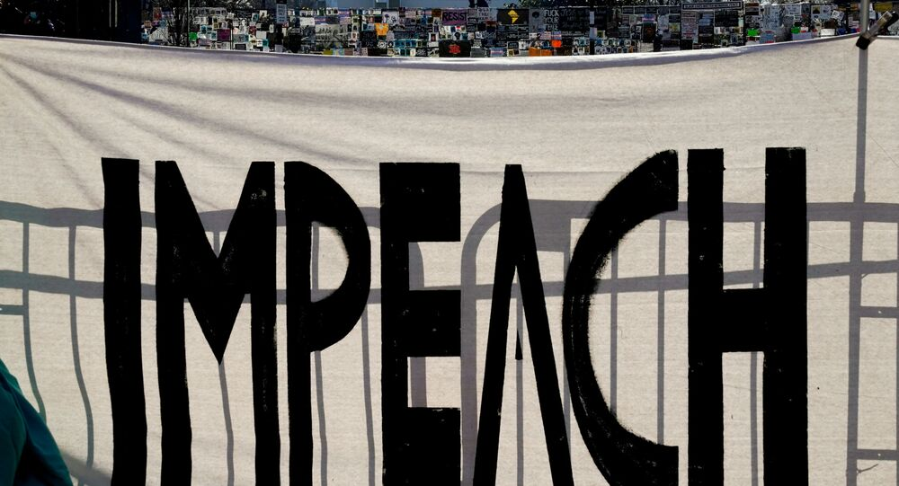 A protest sign reading Impeach is seen on Black Lives Matter Plaza near the White House one week after rioters stormed the U.S. Capitol building in Washington, U.S., January 13, 2021