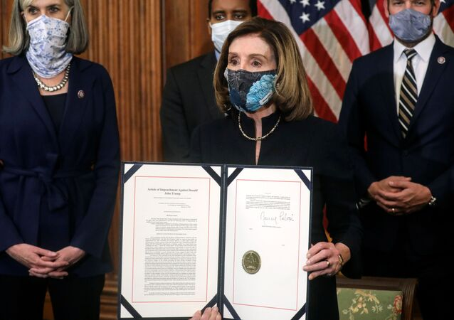 U.S. House Speaker Nancy Pelosi (D-CA) shows the article of impeachment against U.S. President Donald Trump after signing it in an engrossment ceremony, at the U.S. Capitol in Washington January 13, 2021