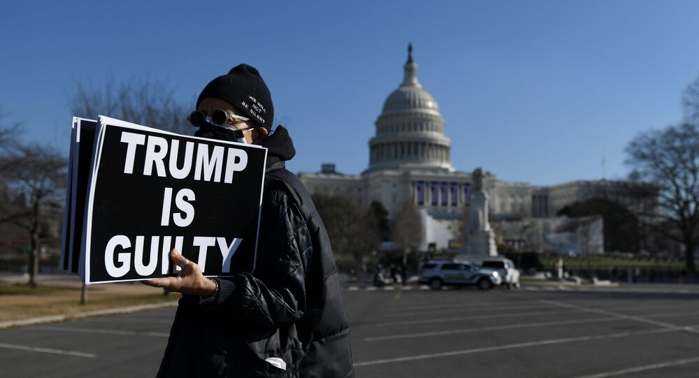 Laurie Arbeiter protests against U.S President Donald Trump near the U.S. Capitol building, as the House of Representatives debates impeaching U.S. President Donald Trump a week after his supporters stormed the Capitol building in Washington, U.S., January 13, 2021.