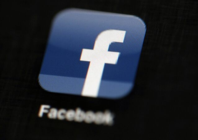 In this May 16, 2012, file photo, the Facebook logo is displayed on a mobile device in Philadelphia
