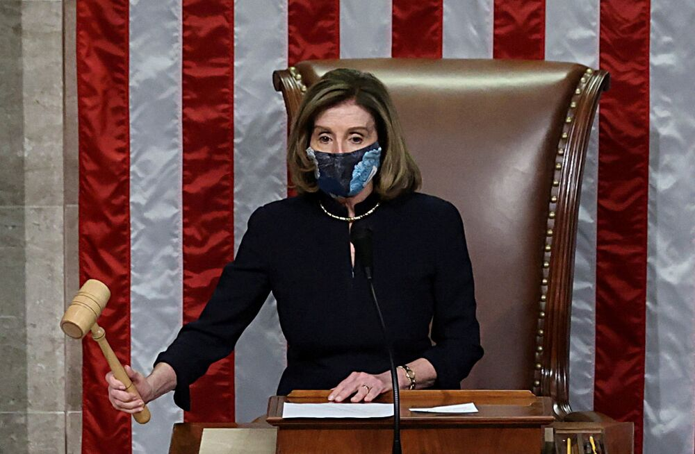 U.S. House Speaker Nancy Pelosi presides over the vote to impeach President Donald Trump for a second time, a week after his supporters stormed the Capitol building, on the floor of the House of Representatives in Washington, 13 January 2021.