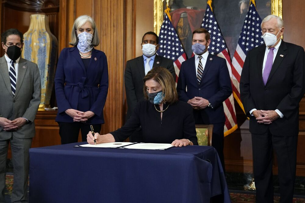 House Speaker Nancy Pelosi signs the article of impeachment against President Donald Trump in an engrossment ceremony before transmission to the Senate for trial on Capitol Hill, in Washington, DC, 13 January 2021.