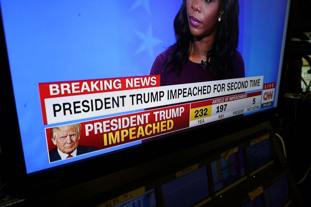 Network monitors inside the White House briefing room display the impeachment proceedings going at the U.S. Capitol against President Donald Trump, Wednesday, Jan. 13, 2021, in Washington.