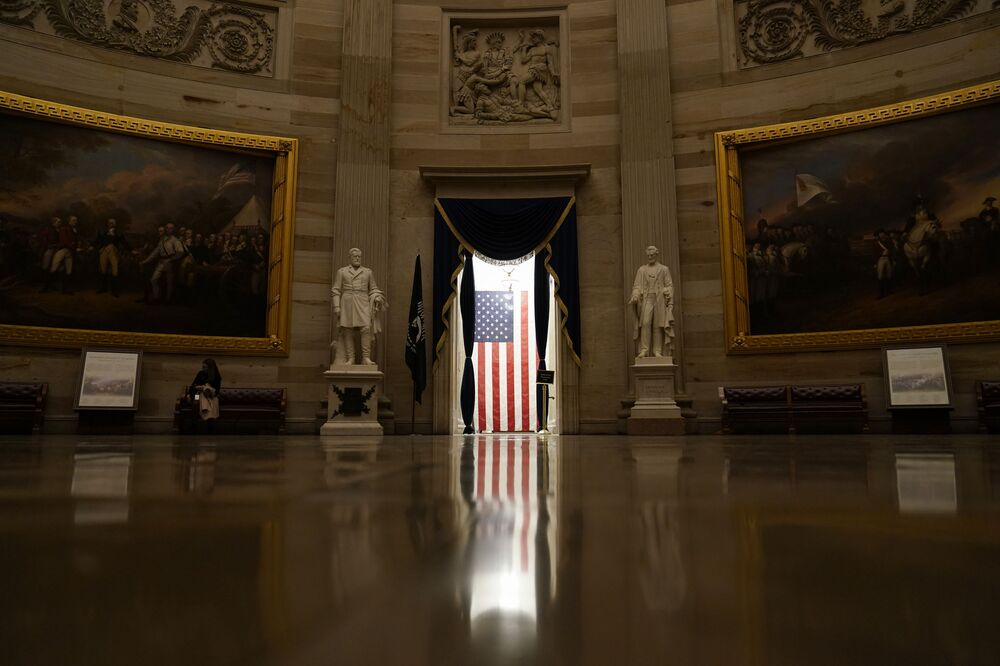 Light shines on an American flag as seen from the Capitol Rotunda in Washington, Wednesday, 13 January 2021.