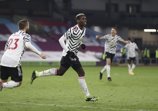 Paul Pogba wheels away after scoring the winning goal for Manchester United against Burnley on 12 January 2021.