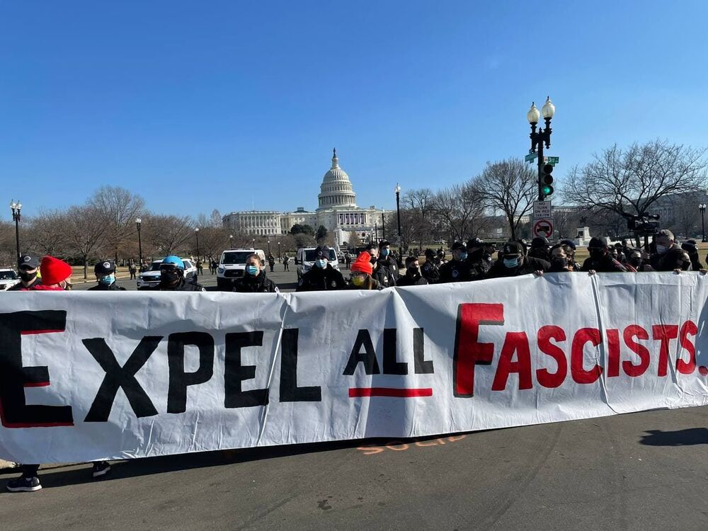 Protesters hold a banner outside the US Capitol.