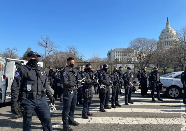 Police officers stand on guard outside US Capitol building as House of Representatives votes to impeach Trump