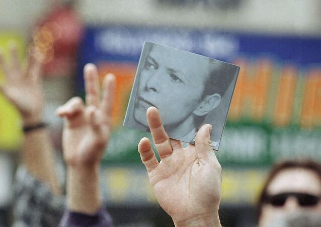A picture of rock-n-roll legend David Bowie is held aloft in the crowd after Bowie received the 2,083rd star on the Hollywood Walk of Fame in Hollywood, Los Angeles, California on Wednesday, 12 February 1997.