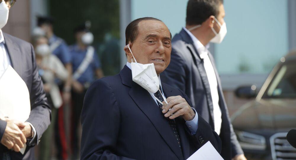 Former Italian Premier Silvio Berlusconi adjusts his face mask as he leaves the San Raffaele hospital in Milan, Italy, Monday, 14 September 2020.
