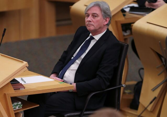 Leader of the Scottish Labour Party Richard Leonard listens as Scottish First Minister Nicola Sturgeon speaks at the Holyrood parliament, as the spread of the coronavirus disease (COVID-19) continues, in Edinburgh, Scotland, Britain, 22 December 2020. REUTERS/Russell Cheyne/Pool