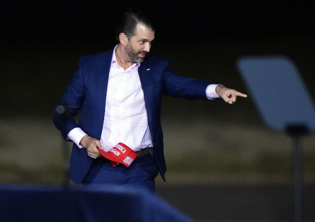 Donald Trump Jr. speaks before President Donald Trump arrives for a campaign rally