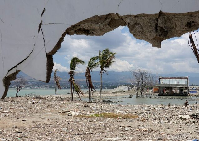 Ruins and damaged building are pictured nearly one year after an earthquake and tsunami at a beach in Palu, Central Sulawesi, Indonesia