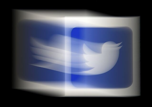 In this file photo taken on August 10, 2020 a photo illustration, a Twitter logo is displayed on a mobile phone in Arlington, Virginia