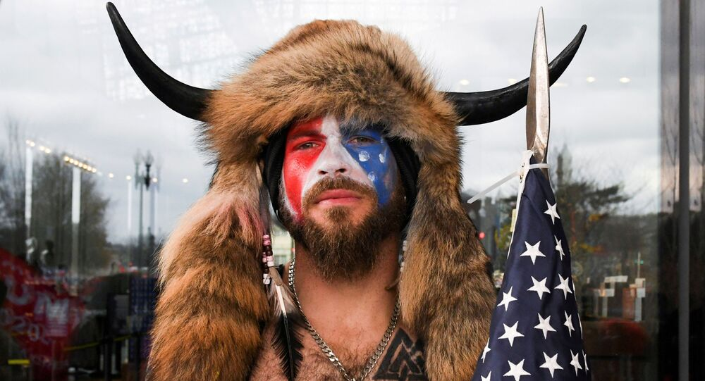 Jacob Anthony Chansley, also known as Jake Angeli, of Arizona, poses with his face painted in the colors of the U.S. flag as supporters of U.S. President Donald Trump gather in Washington, U.S. January 6, 2021