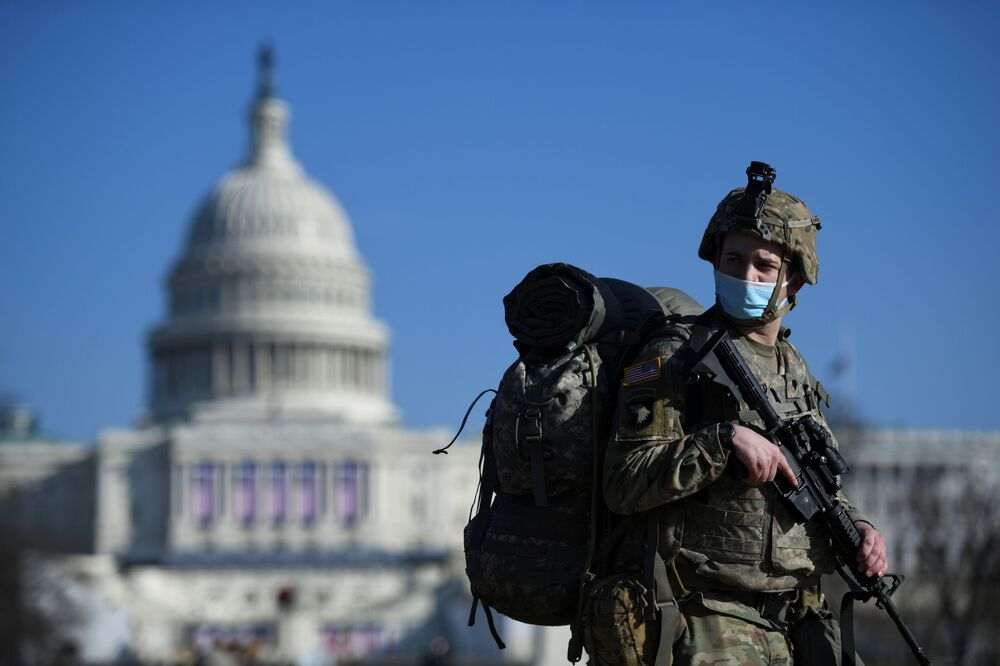 A member of the National Guard mounts guard near the U.S. Capitol building, as the House of Representatives debates impeaching U.S. President Donald Trump a week after his supporters stormed the Capitol building in Washington, 13 January 2021.