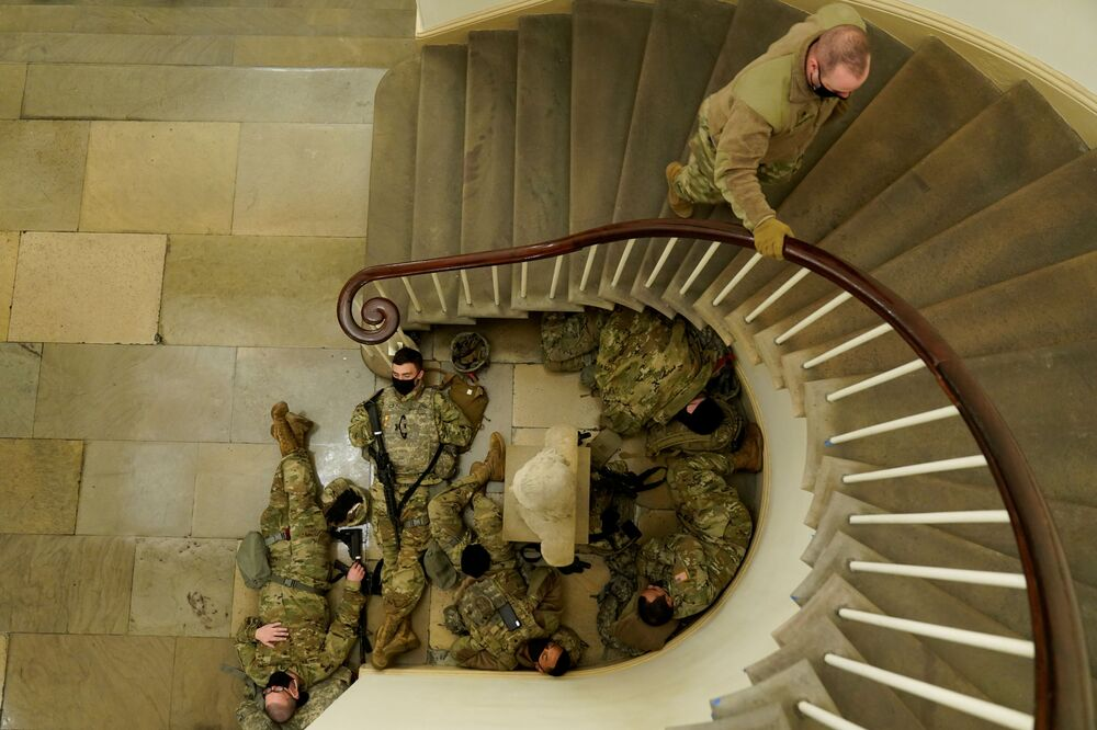 National Guard members sleep before Democrats start debating the article of impeachment against U.S. President Donald Trump at the U.S. Capitol in Washington, 13 January 2021.
