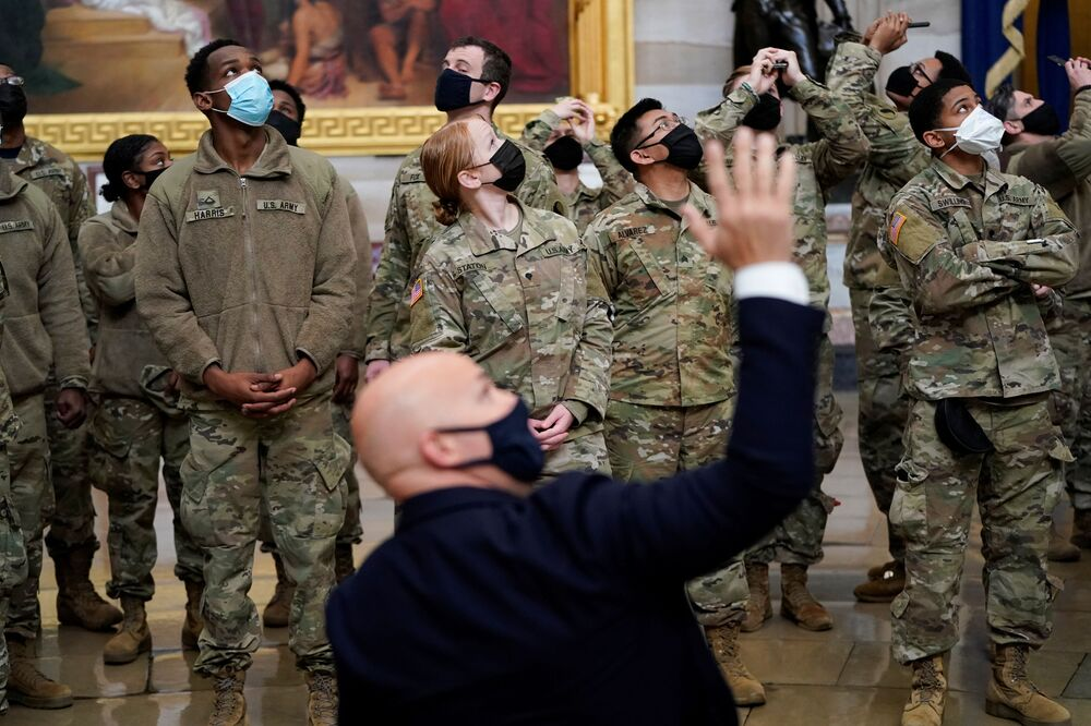 U.S. Rep. Brian Mast leads a tour for members of the National Guard as Democrats debate the  article of impeachment against U.S. President Donald Trump at the U.S. Capitol in Washington, 13 January 2021.