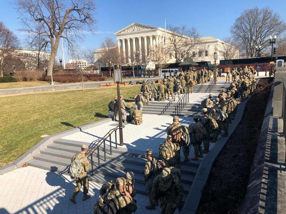 National Guard officers wait outside the US Capitol building in Washington, DC.