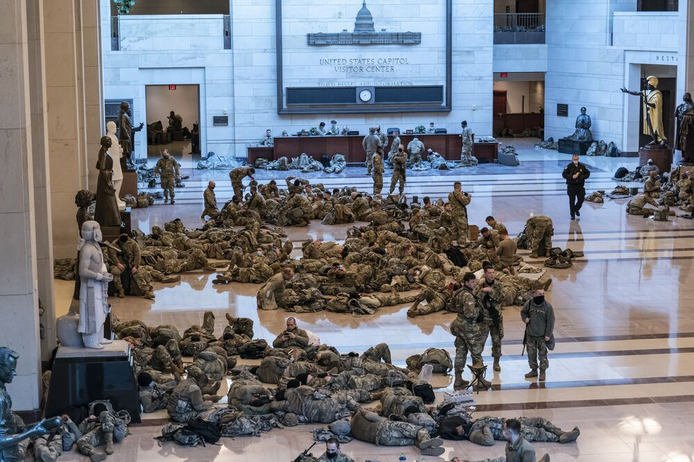 Hundreds of National Guard troops inside the Capitol Visitor's Centre to reinforce security at the Capitol in Washington, 13 January 2021.