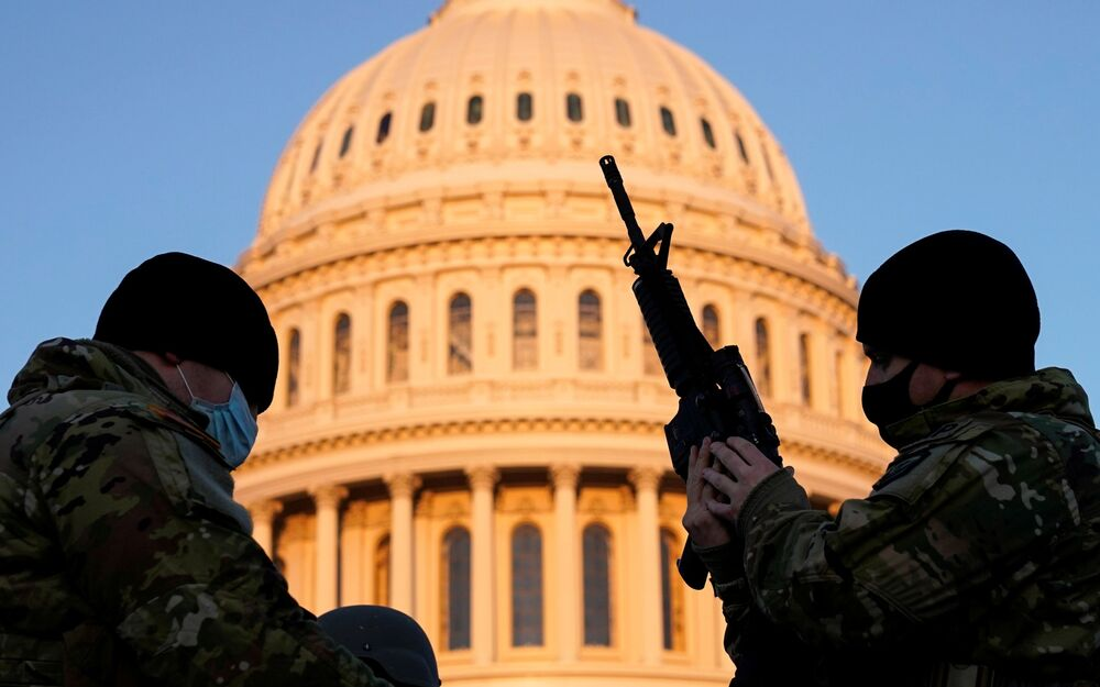 A member of the National Guard is armed before Democrats debate the  article of impeachment against U.S. President Donald Trump at the U.S. Capitol, in Washington, 13 January 2021.