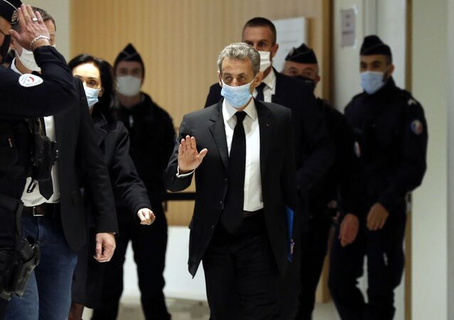 Former French President Nicolas Sarkozy arrives at the courtroom Monday, Dec. 7, 2020 in Paris